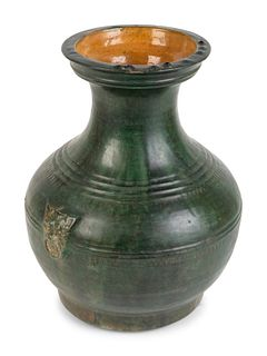 A Chinese Green-Glazed Terracotta Hu-Form Vase Height 14 x diameter 10 1/2 inches.
