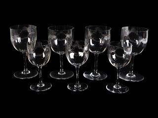 A Baccarat Glass Part Stemware Service Height of taller, 7 inches.