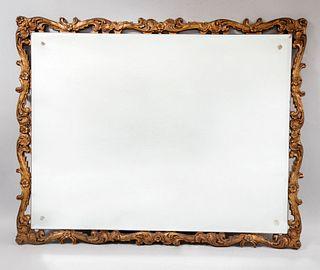 Espejo. SXX. Elaborado en madera y pasta dorada. Con luna rectangular biselada. Decorado con elementos calados y florales. 96 x 77 cm