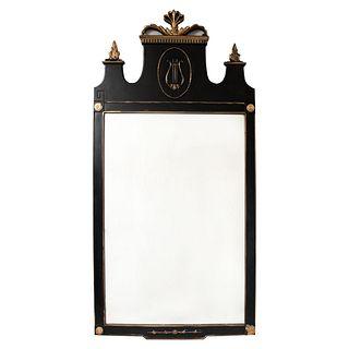 Espejo. Siglo XX. Estilo Imperio. En talla de madera color negro. Con luna rectangular. Decorado con lira y esmalte dorado. 116 x 57 cm