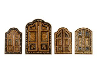 Four Carved and Polychrome-Decorated Doorways Largest: height 32 x width 23 3/4 inches.