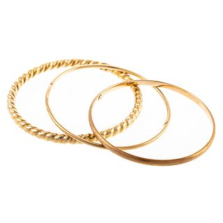 A Collection of Three Bangles in 14K Yellow Gold
