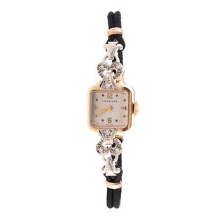 A Ladies Longines Watch with Diamonds in 14K