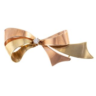 A Vintage Bi-Color Gold Diamond Bow Brooch