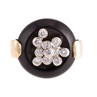 A Black Onyx & Diamond Ring in 14K Yellow Gold