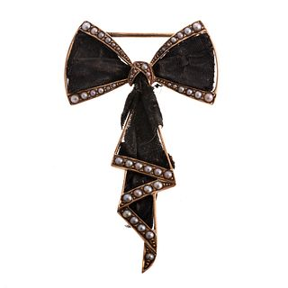 A Victorian Mourning Bow Brooch with Seed Pearls