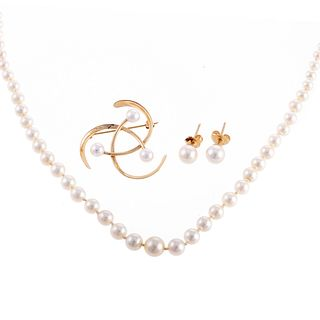 A Collection of Pearl Jewelry in 14K Gold