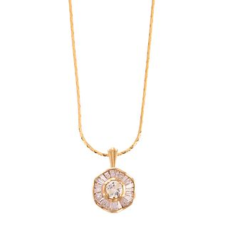 A Diamond Pendant in 18K Hanging on 14K Chain