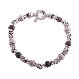 An 18K Link Bracelet with Black Pearls