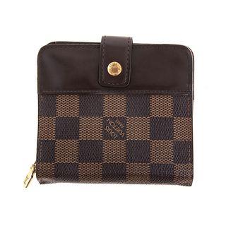 A Louis Vuitton Damier Ebene Compact Zip Wallet