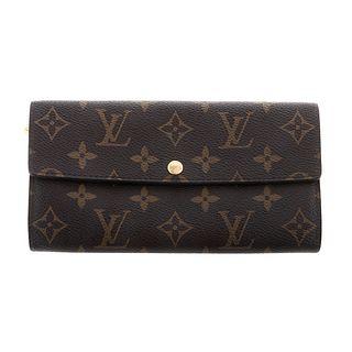 A Louis Vuitton Monogram Sarah Wallet