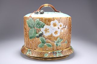 JOSEPH HOLDCROFT  A MAJOLICA CHEESE DOME AND UNDERPLATE, CI