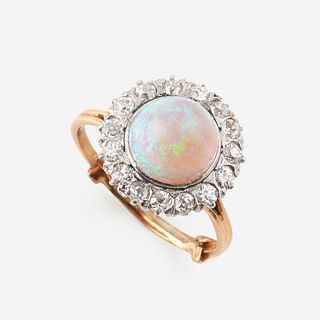 An opal, diamond, and eighteen karat gold ring,