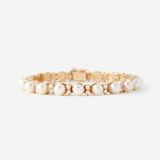 A cultured pearl, diamond, and fourteen karat gold bracelet,
