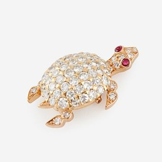 An eighteen karat gold, diamond, and ruby brooch, Cartier, Paris