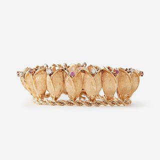 A fourteen karat gold, diamond, and ruby bracelet,