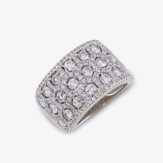 A diamond and fourteen karat white gold ring,