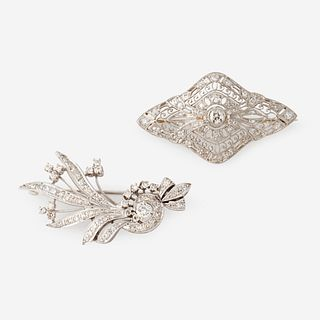 Two fourteen karat white gold and diamond brooches,