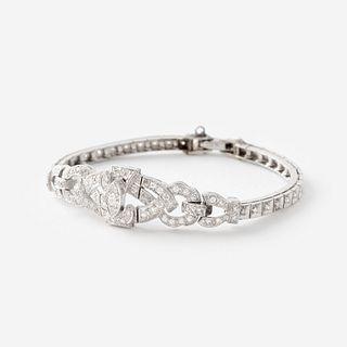 A fourteen karat white gold and diamond bracelet,