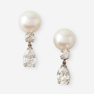 A pair of cultured pearl, diamond, and fourteen karat white gold earrings,