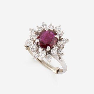 A ruby, diamond, and fourteen karat white gold ring,