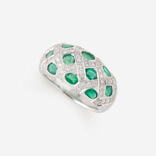 A diamond, emerald, and eighteen karat white gold ring,