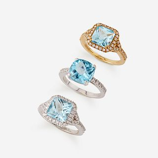 A collection of three blue topaz, diamond, and eighteen karat gold rings,