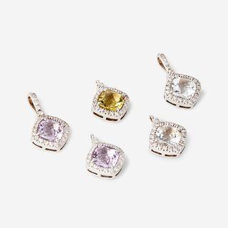 A collection of five gem-set, diamond, and eighteen karat white gold pendants,