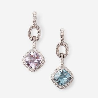 Two gem-set, diamond, and eighteen karat white gold pendants,
