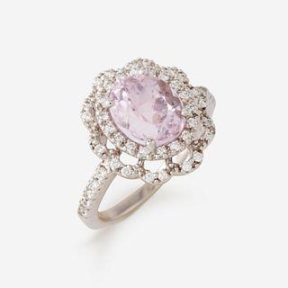 A kunzite, diamond, and eighteen karat white gold ring,