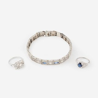 A collection of white gold, platinum, diamond, and sapphire jewelry,