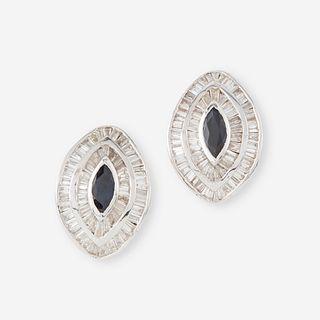 A pair of rhodium plated fourteen karat gold, sapphire, and diamond earrings,