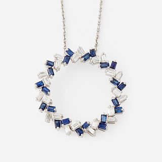 A sapphire, diamond, and platinum pendant,