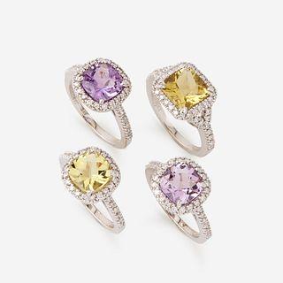 A collection of four quartz, diamond, and eighteen karat white gold rings,