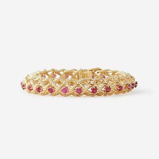 An eighteen karat gold and ruby bracelet, Cartier,