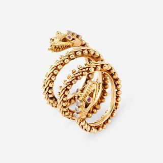 An eighteen karat gold, diamond, and ruby ring,