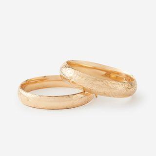 A pair of fourteen karat gold bangles,