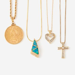 A collection of four gold necklaces,