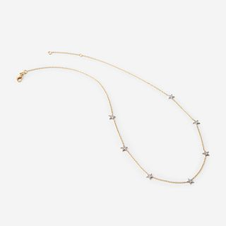 A two-tone eighteen karat gold and diamond necklace,
