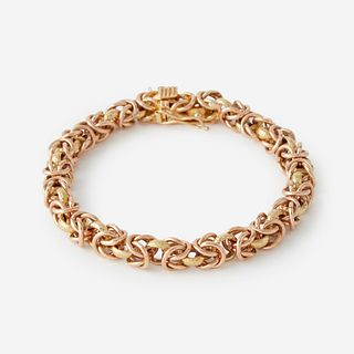 A two tone eighteen karat gold bracelet,