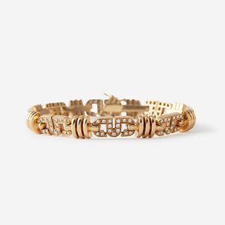 An eighteen karat gold and diamond bracelet,