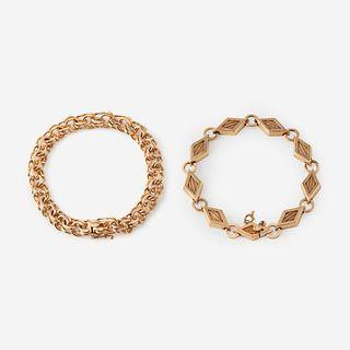 Two fourteen karat gold bracelets,