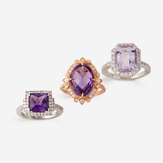 A collection of three amethyst and diamond rings,