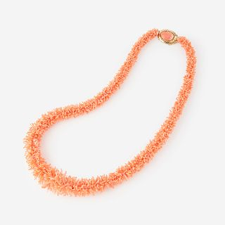 A coral and fourteen karat gold necklace,