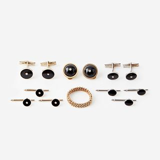 Two onyx, diamond, and fourteen karat gold cufflink and stud sets with matching ear clips and a ring,
