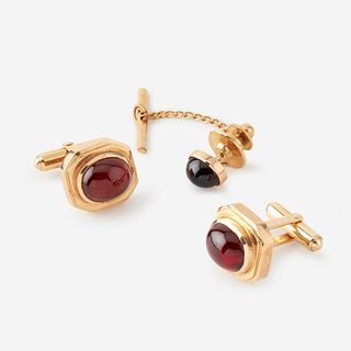 A pair of garnet and fourteen karat gold cufflinks with tie tac,