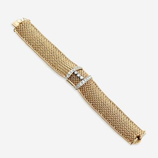 A fourteen karat gold and diamond covered bracelet wristwatch,