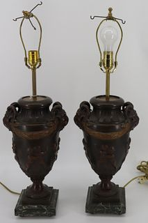 An Antique Pair Of Patinated Metal Urn Form Lamps