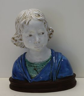 Unsigned Glazed Terracotta Bust of a Child.