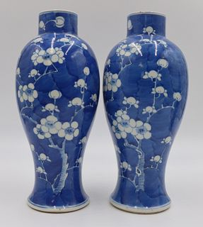 Pair of Chinese Blue and White Prunus Vases.